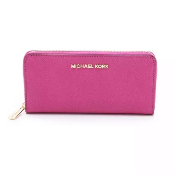 4852312eb055 Michael Kors neon pink jet set continental wallet.  M_5bdbbad5aa87707f35d28b21